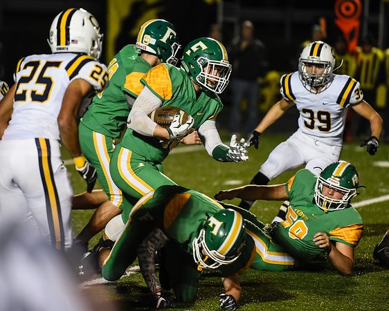 Floyd Central running back Michael Sans rushes the ball up field during the Highlanders match against Castle in the Regional Championship on Friday. Staff photo by Tyler Stewart