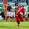 Jeffersonville's D'Andre Rutherford escapes Floyd Central's Devon Stikes as he lands a first down during the Red Devils' game against the Highlanders on Friday.