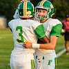 Floyd Central's Matthew Weimer, right, congratulates Jon Gunn after he scored a touchdown against Jeffersonville during the Higlanders' game on Friday.