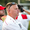 New Albany's head coach Steven Cooley calls a play from the sideline uring the Bulldogs' game against Madison on Friday.