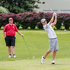 Jack LIlly drives the ball as Jeffersonville's Jay Williams waits behind the tee box during the Hoosier Hill Conference Championship at Elk Run on Saturday. Staff Photo By Josh Hicks