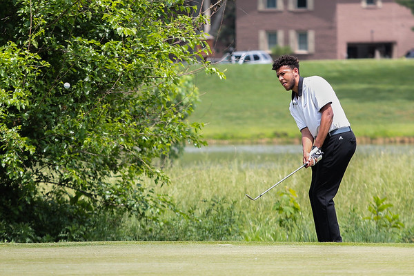 Kameron Guess lobs the ball just off the edge of the green during the Hoosier Hill Conference Championship at Elk Run on Saturday. Staff Photo By Josh Hicks