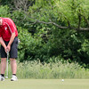 Jeffersonville's Allen Crews sinks a bogey on the first hole during the Hoosier Hill Conference Championship at Elk Run on Saturday. Staff Photo By Josh Hicks