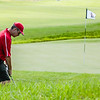 Jeffersonville's Jay Williams chips the ball off the back of the 8th green during the Regional game at Champion Pointe in Henryville on Thursday. Staff Photo By Josh Hicks
