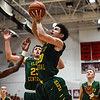 Floyd Central guard Cobie Barnes puts up a shot after grabbing the offernsive rebound over the New Albany defense during the Bulldogs' 65-42 win over the Highlanders on Friday. Staff photo by Tyler Stewart
