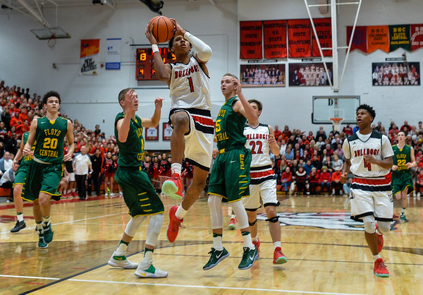 New Albany forward Romeo Langford draws a foul on the Floyd Central defense as he takes the ball in for a layup during the Bulldogs' 65-42 win over the Highlanders on Friday. Staff photo by Tyler Stewart