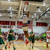 New Albany forward Romeo Langford dunks the ball over the Floyd Central defense after a fast break during the Bulldogs' 65-42 win over the Highlanders on Friday. Staff photo by Tyler Stewart