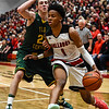 New Albany forward Romeo Langford breaks past Floyd Central's Brendon Hobson during the Bulldogs' 65-42 win over the Highlanders on Friday. Staff photo by Tyler Stewart