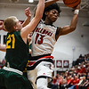 New Albany guard Savion Southers brings down the offensive rebound over Floyd Central's Gabe Shireman during the Bulldogs' 65-42 win over the Highlanders on Friday. Staff photo by Tyler Stewart