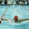 Jeffersonville's Carter Dilger reaches the end of a lap while competing in the 100 yard butterfly during the Red Devils' meet against Floyd Central on Thursday. Staff photo by Tyler Stewart