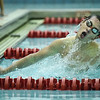 Floyd Central's Noah McIntire pushes off the wall after making a turn while competing in the 100 yard breaststroke during the Highlanders' meet against Jeffersonville on Thursday. Staff photo by Tyler Stewart