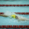 Floyd Central's Christian Salinas competes in the 100 yard backstroke during the Highlanders' meet against Jeffersonville on Thursday. Staff photo by Tyler Stewart