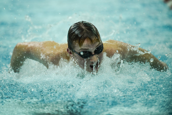 Floyd Central's Tristan Deaton competes in the 100 yard butterfly during the Highlanders' meet against Jeffersonville on Thursday. Staff photo by Tyler Stewart