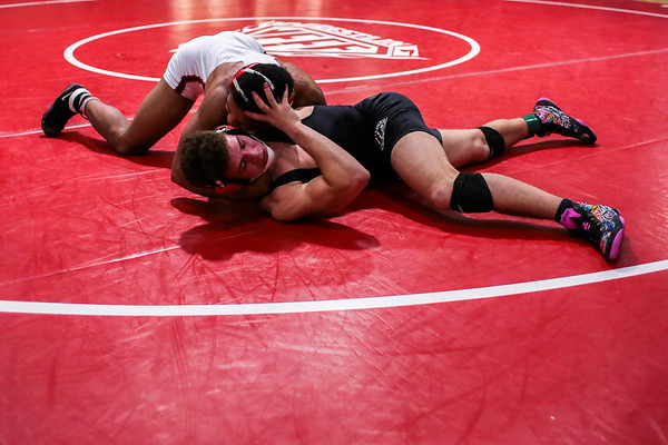 New Albany's Aaron Mosley defeats Jeffersonville's Kam Fuller during the Wrestling Sectional at Johnson Arena on Saturday. Staff Photo By Josh Hicks