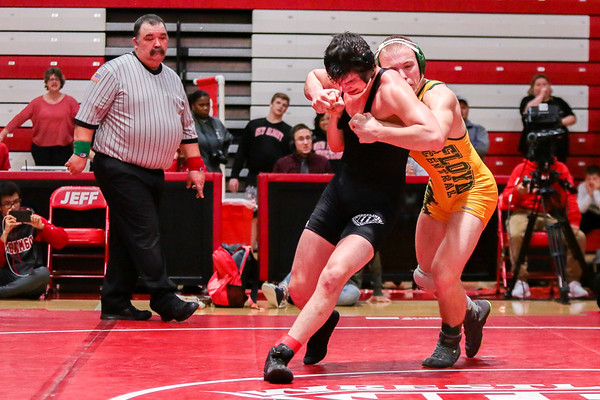 Jeffersonville's Jack Ferrarro narrowly escapes Floyd Central's Corbin Hale during the Wrestling Sectional at Johnson Arena on Saturday. Staff Photo By Josh Hicks