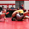 Floyd Central's Tristan Sellmer stays on top of New Albany's Ronald Johnson during the Wrestling Sectional at Johnson Arena on Saturday. Staff Photo By Josh Hicks