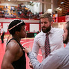 Jeffersonville's Josiah Freeman speaks with his coaches after losing a match to Floyd Central's Devon Stykes