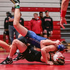 New Washington's Noah Franklin flys over Jeffersonville's Noah Morrison for a win during the Wrestling Sectional at Johnson Arena on Saturday. Staff Photo By Josh Hicks.