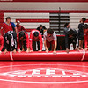 Jeffersonville rolls up their mats after the Wrestling Sectional at Johnson Arena on Saturday. Staff Photo By Josh Hicks