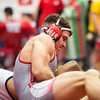 Jeffersonville junior Kameron Fuller traps Moore Traditional High School by the chest during Jeffersonville High School's Wrestling Classic on Saturday. Staff Photo By Josh Hicks