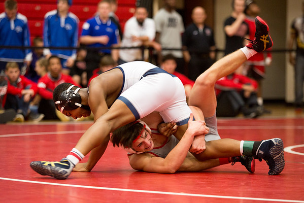 Jeffersonville sophomore Isaac Hall regains his footing after sweeping the leg out from under his opponent during Jeffersonville High School's Wrestling Classic on Saturday. Staff Photo By Josh Hicks