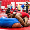 New Albany junior Aaron Mosley pins Oldham County wreslter during Jeffersonville High School's Wrestling Classic on Saturday. Staff Photo By Josh Hicks