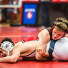 New Albany senior Tristan Dowell takes down an oponent from Kentucky's Moore Traditional High School during Jeffersonville High School's Wrestling Classic on Saturday. Staff Photo By Josh Hicks