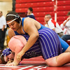Charlestown sophomore Sean Baker keeps Bloomington South against the mat during Jeffersonville High School's Wrestling Classic on Saturday. Staff Photo By Josh Hicks