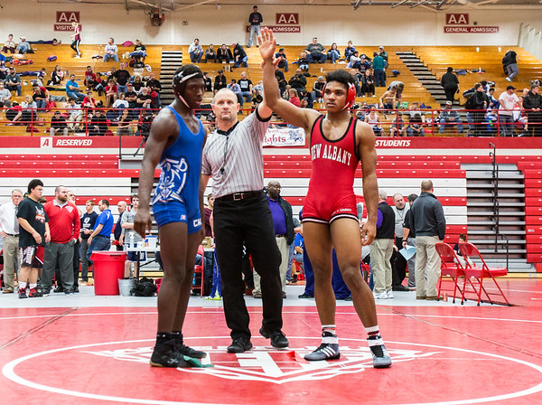 New Albany junior Aaron Mosley defeats Charlestown Pirate during Jeffersonville High School's Wrestling Classic on Saturday. Staff Photo By Josh Hicks