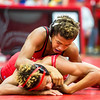 New Albany sophomore Dayton Hunter tames a Madison Cub opponent during Jeffersonville High School's Wrestling Classic on Saturday. Staff Photo By Josh Hicks