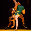 """Floyd Central's Devon Stikes slams his St. Xavier opponent during """"Rage on The Stage"""" on Friday. Staff Photo By Josh Hicks"""