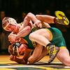 """Floyd Central's Josh Foster locks down St. Xavier during """"Rage on The Stage"""" on Friday. Staff Photo By Josh Hicks"""