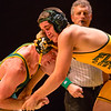 "Floyd Central's Eric Micco butts heads with his St. Xavier opponent during ""Rage on The Stage"" on Friday. Staff Photo By Josh Hicks"