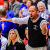 Silver Creek head coach Scott Schoen motions for his team to hustle down court during their game against Jeffersonville on Friday. Staff Photo By Josh Hicks
