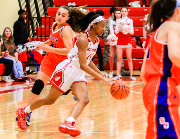 Jeffersonville's Jhala Henry floats by Silver Creek's defense during their game at Jeffersonville High School on Friday. Staff Photo By Josh Hicks