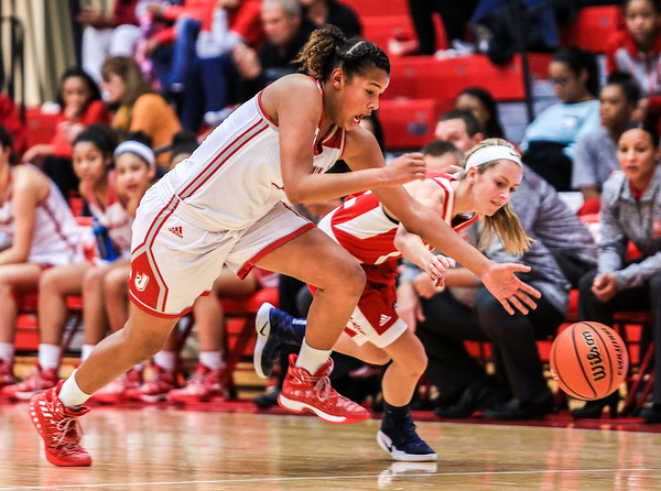 Jeffersonville's Nan Garcia smacks the ball away from Bedford North Lawrence during their game at Johnson Arena on Saturday. Staff Photo By Josh Hicks