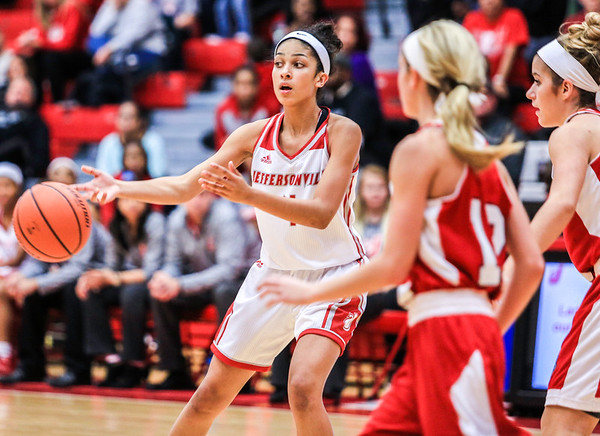 Jeffersonville's Tori Handley floats a short pass during their game against Bedford North Lawrence at Johnson Arena on Saturday. Staff Photo By Josh Hicks