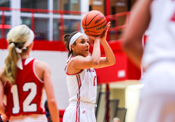 Jeffersonville's Jacinta Gibson takes a long shot during their game against Bedford North Lawrence at Johnson Arena on Saturday. Staff Photo By Josh Hicks
