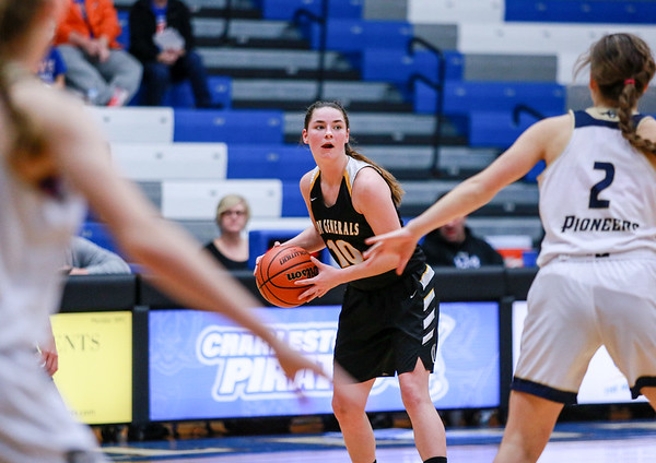 Clarksville's Kayla Isgrigg looks through a veil of defense for a pass during their Holiday Tournament game against Providence at Charlestown High School on Thursday. Staff Photo By Josh Hicks