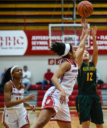 Floyd Central guard Gracie Fitzgerald takes a short-range shot over the Jeffersonville defender during the Red Devils' 35-24 win over the Highlanders on Thursday. Staff photo by Tyler Stewart