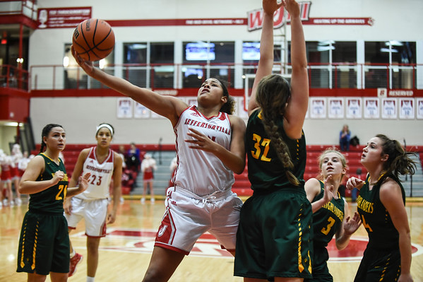 Jeffersonville forward Nan Garcia breaks past Floyd Central defender Grace Hale as she attempts a layup during the Red Devils' 35-24 win over the Highlanders on Thursday. Staff photo by Tyler Stewart