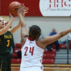 Floyd Central guard Kalissa Fosskuhl attempts a 3-pointer over Jeffersonville defender Nan Garcia during the Red Devils' 35-24 win over the Highlanders on Thursday. Staff photo by Tyler Stewart