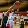 Jeffersonville forward Jaelyn Lee pulls down the rebound over the Floyd Central offense during the Red Devils' 35-24 win over the Highlanders on Thursday. Staff photo by Tyler Stewart