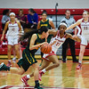 Floyd Central guard Gracie Fitzgerald is pressured by Jeffersonville defender Jhala Henry as she looks for an open teammate during the Red Devils' 35-24 win over the Highlanders on Thursday. Staff photo by Tyler Stewart