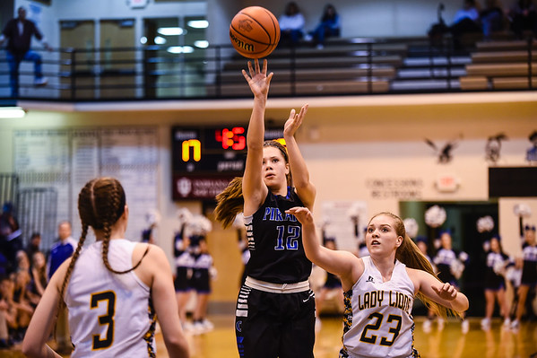 Charlestown's Peyton Crace pulls up for a shot between Salem defenders Ansley Walton (3) and Liz Weaver (23) during the Pirates' 55-51 win over the Lions in the Class 3A Corydon Sectional on Wednesday. Staff photo by Tyler Stewart