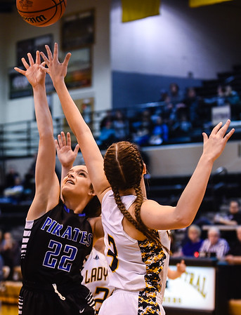 Charlestown's Erin Kimbrell fights for the offensive rebound against Salem's Ansley Walton during the Pirates' 55-51 win over the Lions in the Class 3A Corydon Sectional on Wednesday. Staff photo by Tyler Stewart