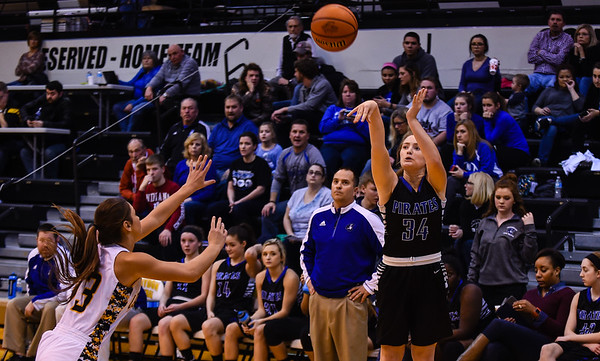 Charlestown's Samantha Matthews hits a 3-pointer off an in-bounds play as Salem's Alaina Davidson rushes to defend during the Pirates' 55-51 win over the Lions in the Class 3A Corydon Sectional on Wednesday. Staff photo by Tyler Stewart