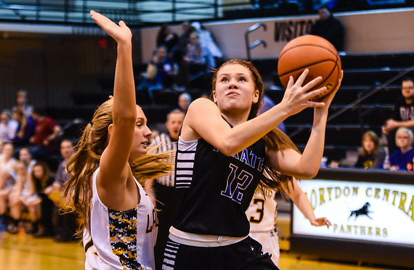Charlestown's Peyton Crace drives for a layup against Salem's Jamie Taylor during the Pirates' 55-51 win over the Lions in the Class 3A Corydon Sectional on Wednesday. Staff photo by Tyler Stewart