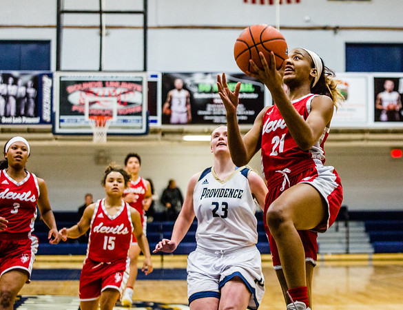 Jeffersonville's Jhala Henry goes in for two during their game against Providence on Tuesday. Staff Photo By Josh Hicks