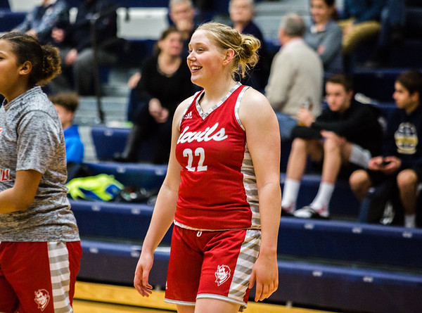Jeffersonville's Britney Epperson smiles as she warms up during half time before taking on Providence on Tuesday. Staff Photo By Josh Hicks